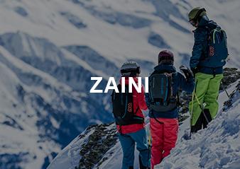 Tre persone che scalano un montagna innevata